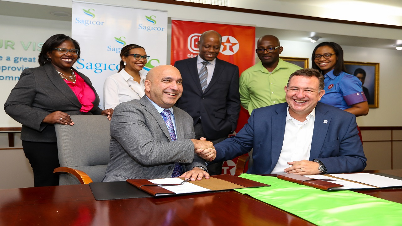 Christopher Zacca (left), President and CEO of Sagicor Group Jamaica and Mauricio Pulido, CEO of GB Energy Texaco shake hands following the signing of a new lease agreement for the establishment of a gas station at the 
