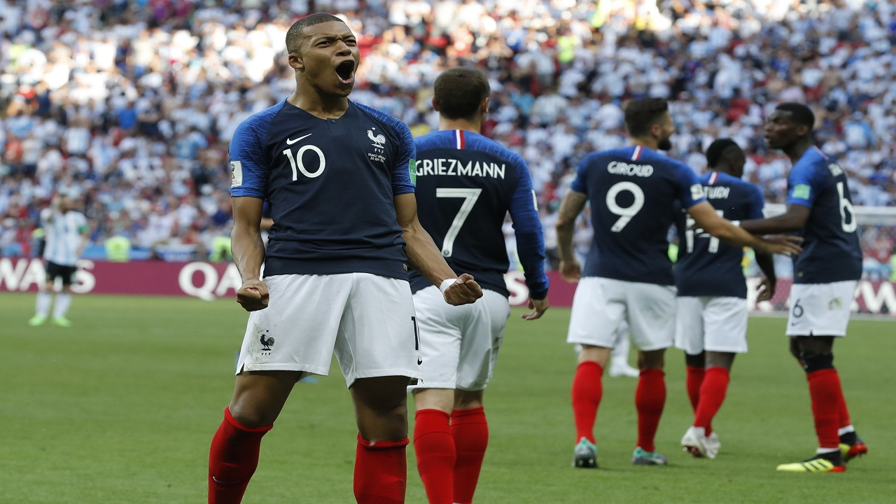 France's Kylian Mbappe celebrates after scoring his side's third goal during the round of 16 match against Argentina, at the 2018 football World Cup at the Kazan Arena in Kazan, Russia, Saturday, June 30, 2018. (AP Photo/David Vincent).