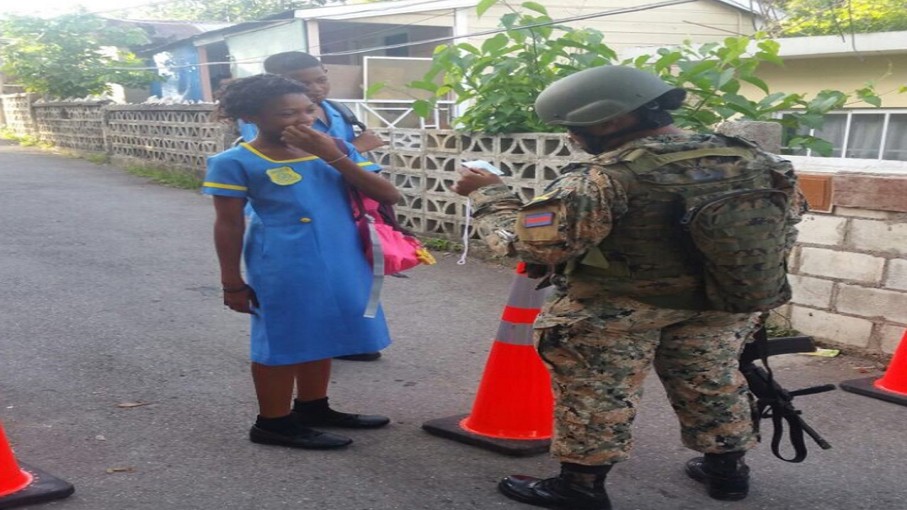 A soldier check the ID of a student resident of Mount Salem, St James last September. Photo via ZOSO Communications.