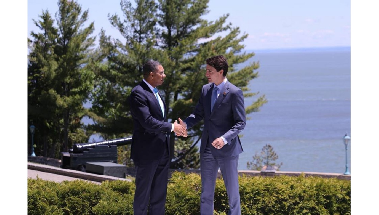Prime Minister Andrew Holness being greeted by Justin Trudeau, Canada's Prime Minister, after arriving at the G7 Summit. (PHOTO: OPM)