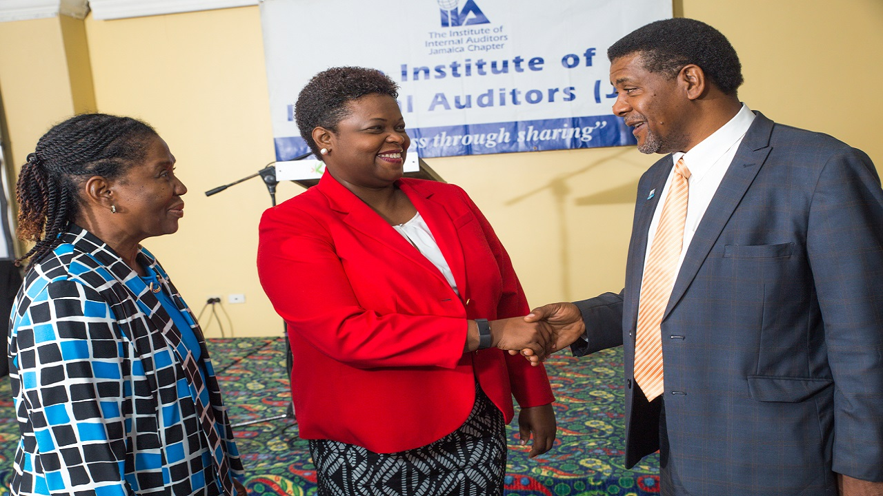CEO of First Heritage Co-operative Credit Union (FHC) Roxann Linton (c) and the Institute of Internal Auditors (IIA) Jamaica Chapter President Simone Ramsay-Knight (l) and Chairman of the Board of Governors Collin Greenland (r) exchange pleasantries ahead of the IIA's 2018 Business Conference held at the Knutsford Court Hotel.