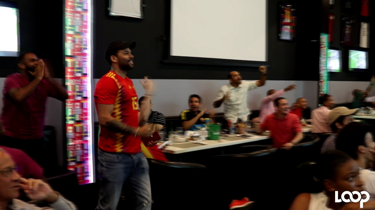 Football fans watch the Spain vs Portugal World Cup match at 100 Hope Road.
