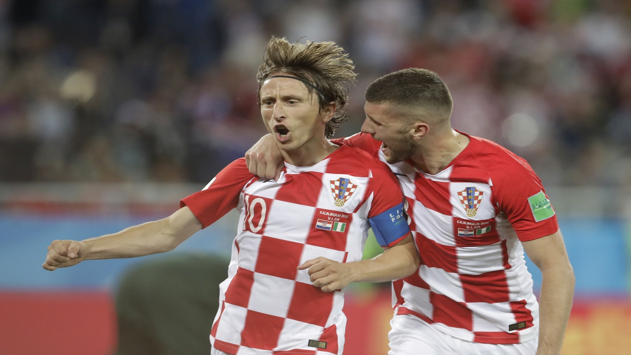 Croatia's Luka Modric, left, celebrates with teammate Ante Rebic after scoring from a penalty spot during the group D match against Nigeria at the 2018 football World Cup in the Kaliningrad Stadium in Kaliningrad, Russia, Saturday, June 16, 2018. (AP Photo/Petr David Josek).