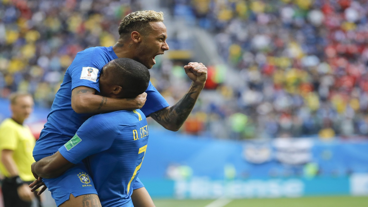 Brazil's Neymar, top, celebrates with teammate Douglas Costa after scoring his side's second goal during the group E match against Costa Rica at the 2018 football World Cup in the St. Petersburg Stadium in St. Petersburg, Russia, Friday, June 22, 2018. (AP Photo/Dmitri Lovetsky).