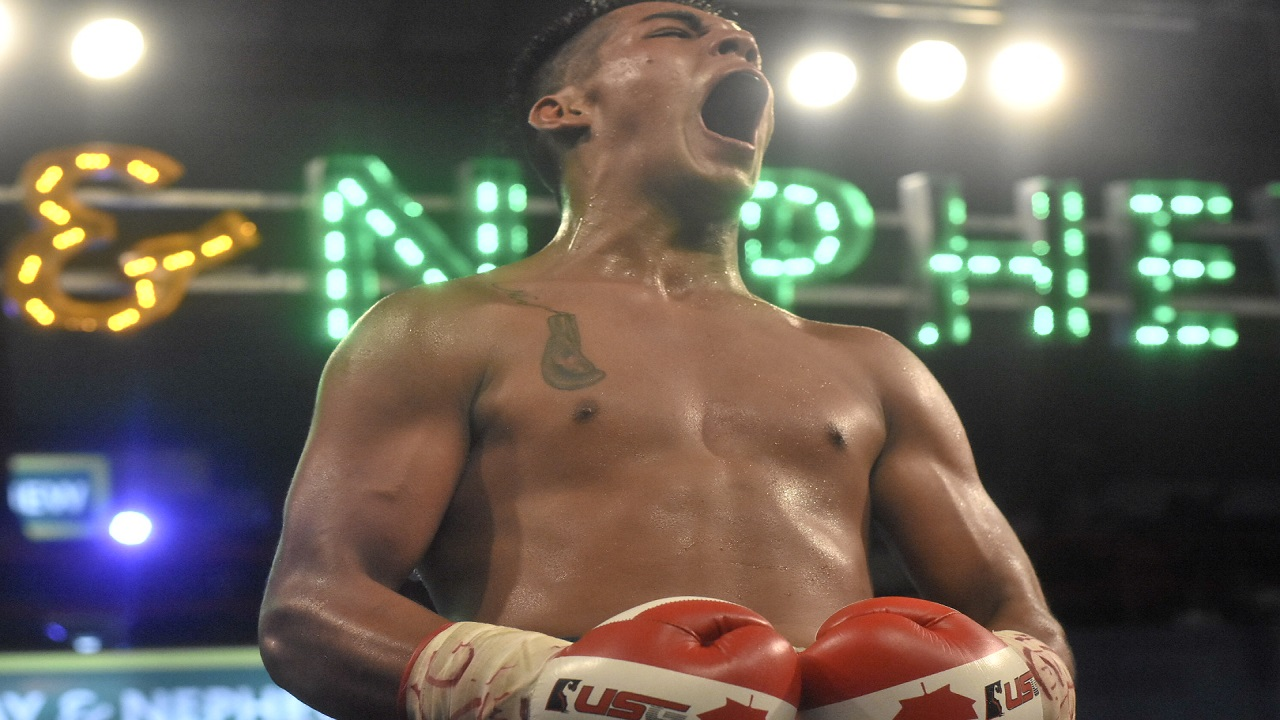 Ricardo Salas of Team Canada reacts after his fifth-round technical knockout victory  over Jamaica's Nico Yeyo on Wednesday night in the last quarter-final bout of Season 8 of the Wray and Nephew Contender welterweight series, at the Chinese Benevolent Association. (PHOTO: Marlon Reid).