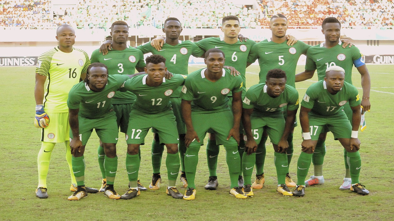 In this photo taken Saturday October 7, 2017, Nigeria's line up team poses for photos before a World Cup football qualifier match against Zambia at Godswill Akpabio Stadium in Uyo Nigeria. (AP Photo/Segun Ogunfeyitimi )