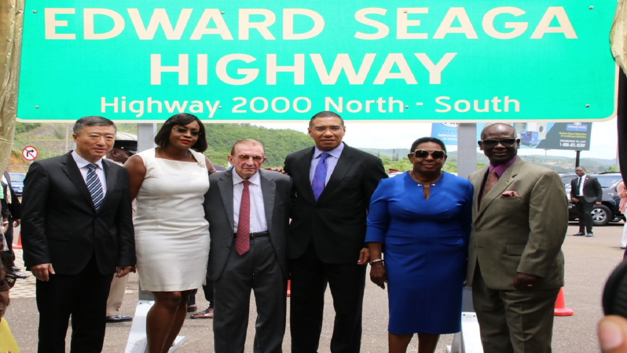 L-R: Ambassador of the People's Republic of China to Jamaica, Tian Qi; Juliet Holness, wife of Prime Minister Andrew Holness; former Prime Minister Edward Seaga; Prime Minister Andrew Holness; Culture Minister Olivia Grange; and Local Government Minister Desmond McKenzie following the official renaming ceremony for the Edward Seaga Highway.