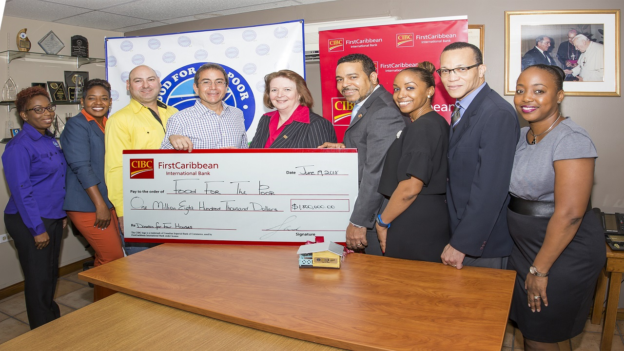 Food for the Poor and CIBC executives at the handing over of the bank's donation.