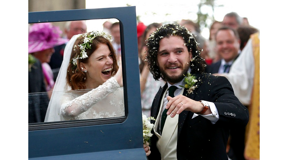 Actors Kit Harington and Rose Leslie reacts as they leave after their wedding ceremony, at Rayne Church, Kirkton of Rayne in Aberdeenshire, Scotland, Saturday June 23, 2018.