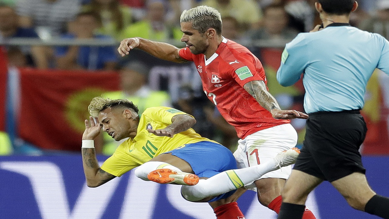 Brazil's Neymar, left, and Switzerland's Valon Behrami challenge for the ball during the group E match at the 2018 football World Cup in the Rostov Arena in Rostov-on-Don, Russia, Sunday, June 17, 2018. (AP Photo/Felipe Dana).