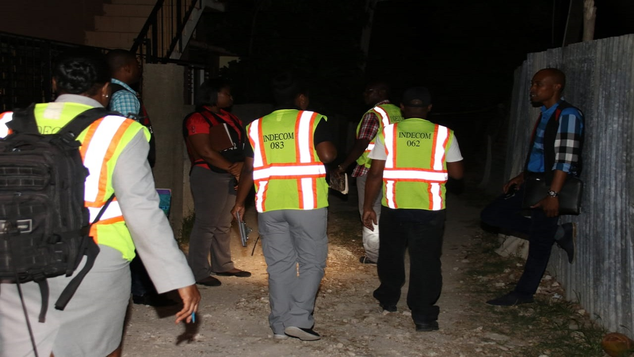 Members of the Independent Commission of Investigations arrive on the scene of the fatal police shooting in Braeton on Friday.