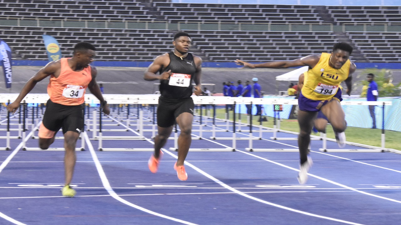 Damion Thomas (right) of Louisiana State University wins the Boys' Under-20 110-metre hurdles on Saturday at the National Junior and Senior Championships, at the National Stadium. Thomas won in 12.99 seconds to equal the world junior record.  Orlando Bennett (left) and Dejour Russell (centre) finished second and third. (PHOTO: Marlon Reid).