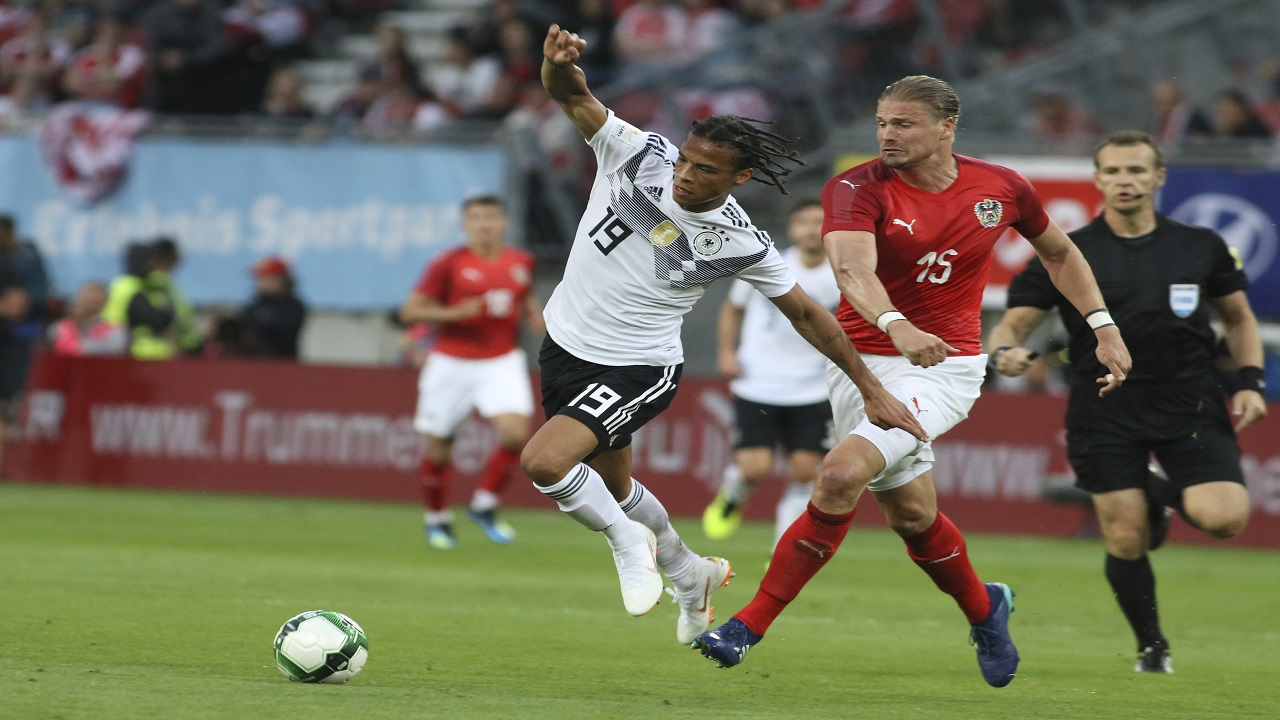 Germany's Leroy Sane, left, vies for the ball with Austria's Sebastian Prodl during a friendly soccer match between Austria and Germany in Klagenfurt, Austria, Saturday, June 2, 2018. (AP Photo/Ronald Zak)