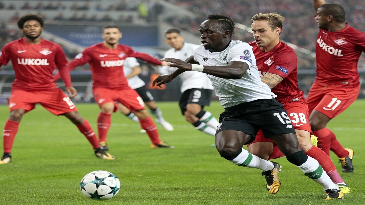 Liverpool's Sadio Mane, front, duels for the ball with Spartak's Andrei Eschenko during the Champions League football match between Spartak Moscow and Liverpool in Moscow. (PHOTO: AP)