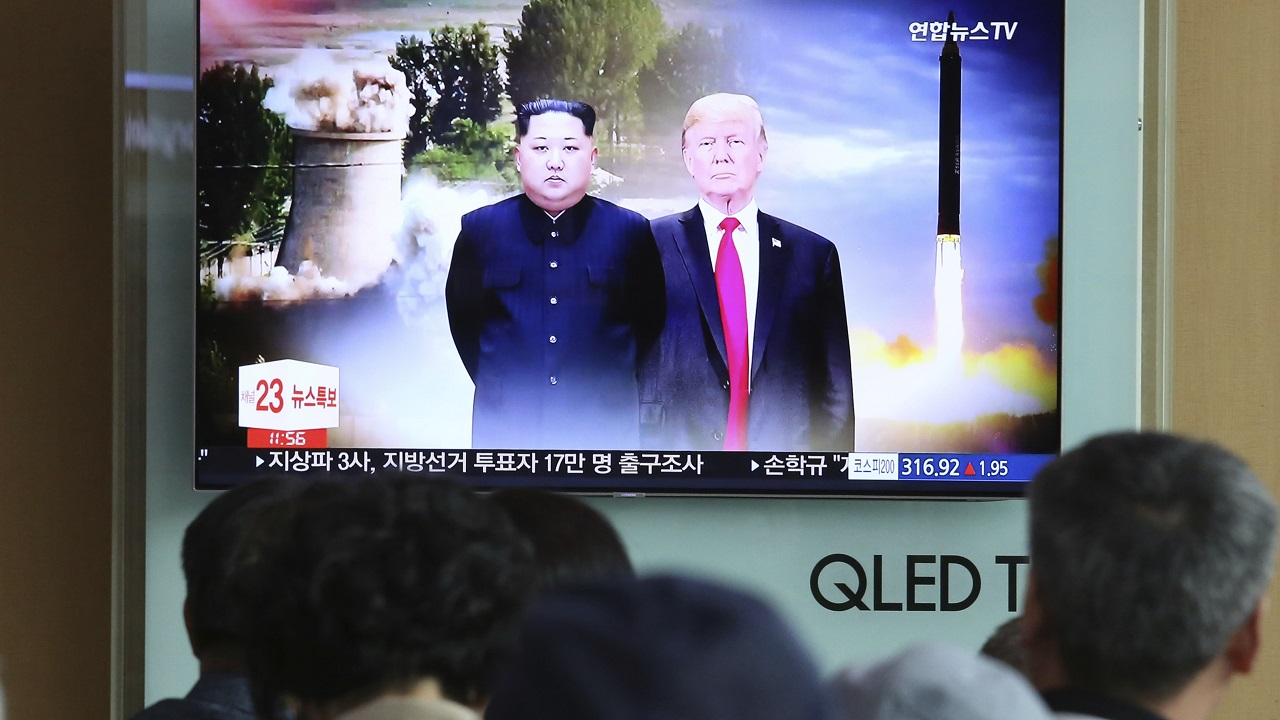 (Image:AP: People watch summit coverage at a railway station in Seoul, South Korea, on 11 June 2018)