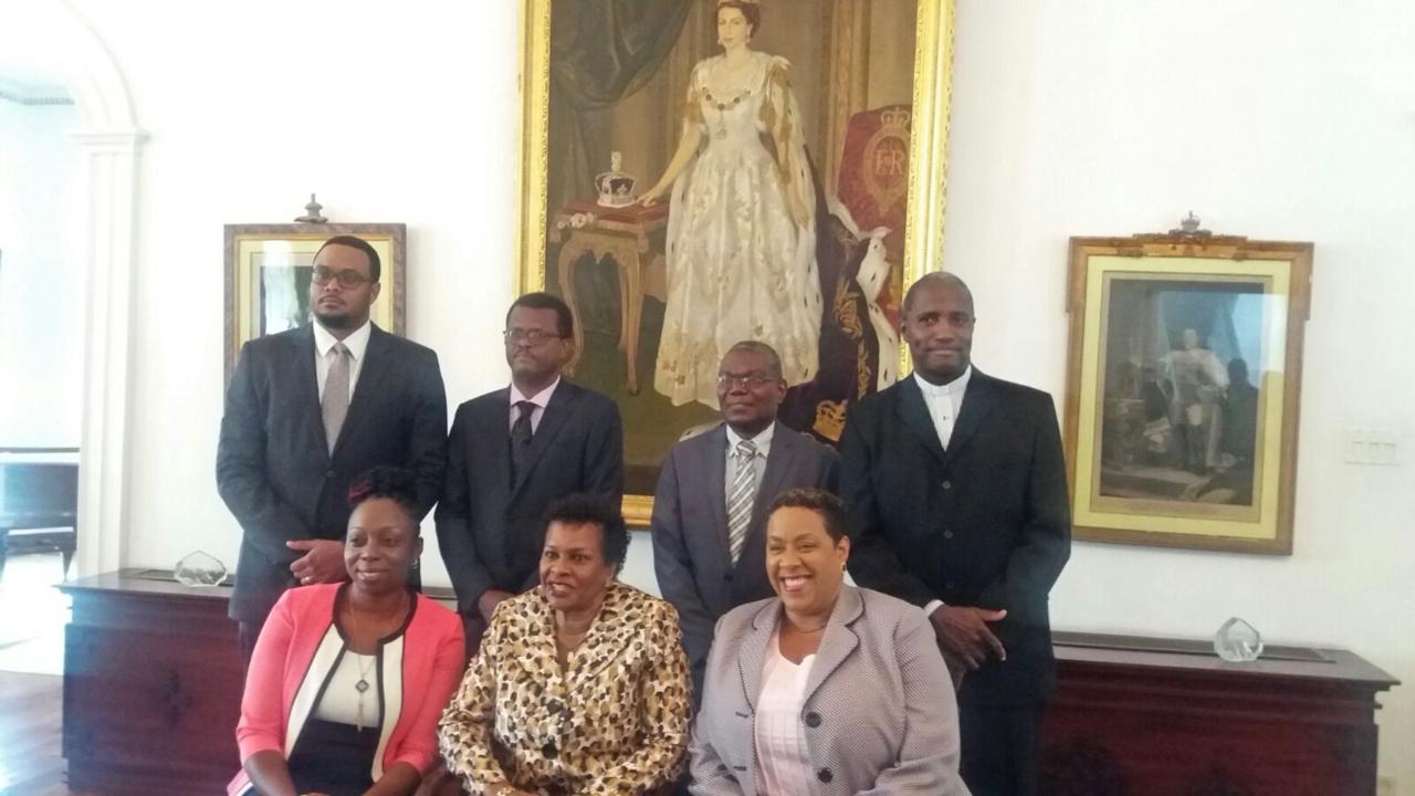 L-R front row: Senator Toni Moore, Governor General Dame Sandra Mason, Senator Monique Taitt. L-R back row: Senator Kevin Boyce, Senator Christopher Maynard, Senator Lindell Nurse, Senator Reverend Michael Maxwell.