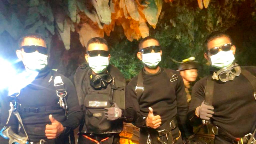 In this undated photo released by Royal Thai Navy on Tuesday, July 10, 2018 show the last four Thai Navy SEALs come out safely after completing the rescued mission inside a cave where 12 boys and their soccer coach have been trapped since June 23. (Royal Thai Navy via AP)