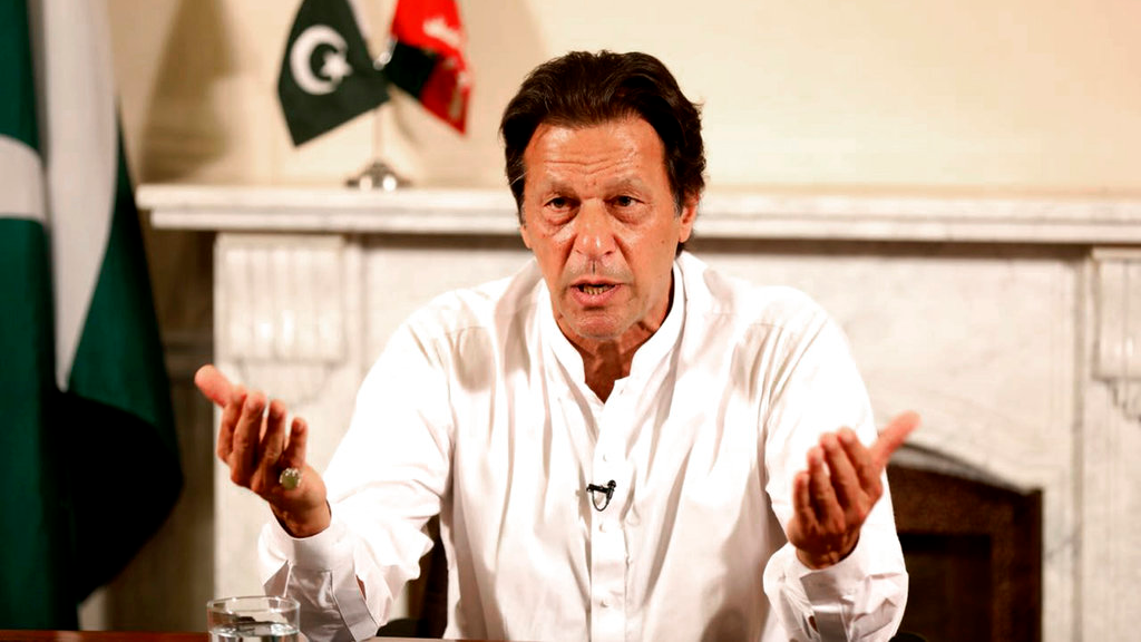 In this photo provided by the office of Pakistan Tehreek-e-Insaf party, Pakistani politician Imran Khan, chief of Pakistan Tehreek-e-Insaf party, delivers his address in Islamabad, Pakistan, Thursday, July 26, 2018. (Tehreek-e-Insaf via AP)