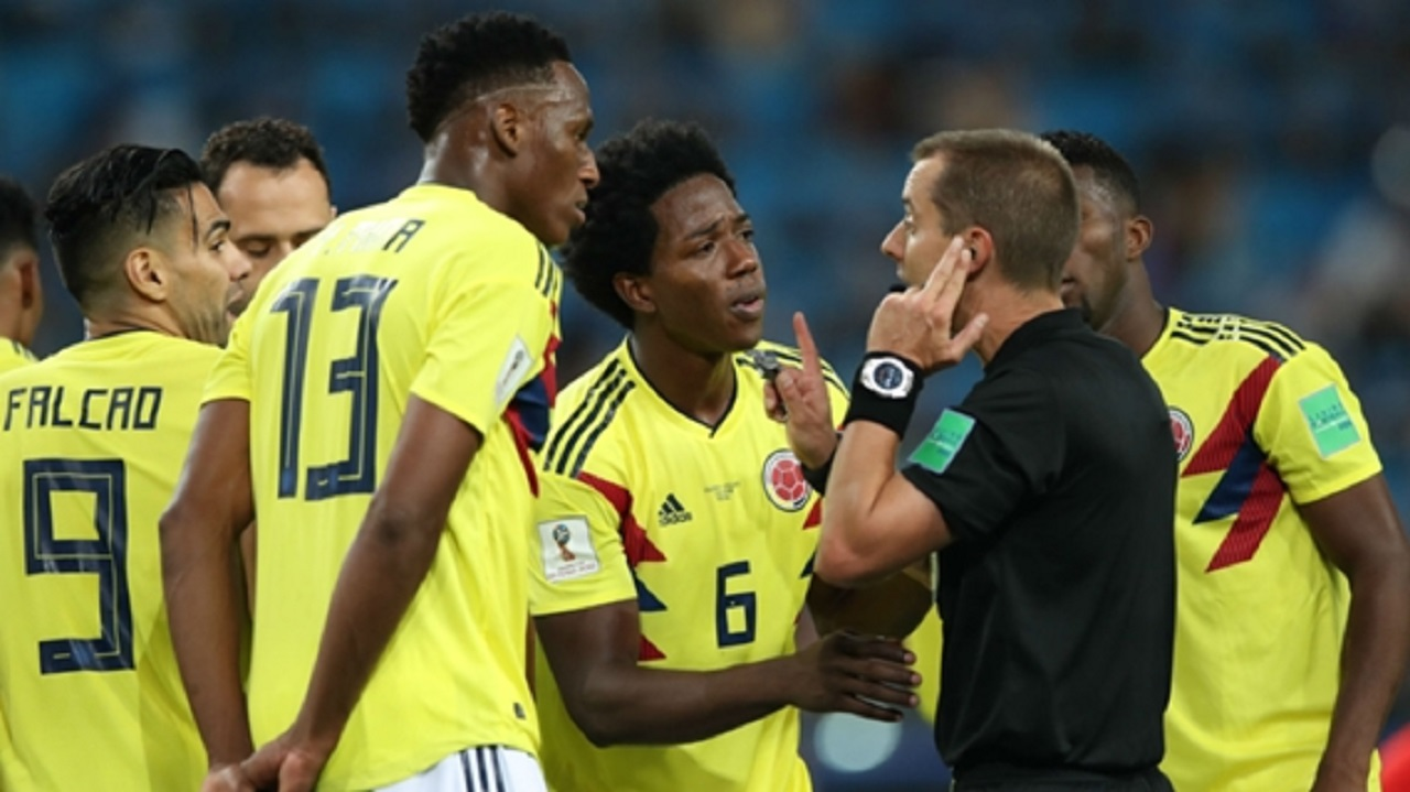 Colombia's Carlos Sanchez after conceding a penalty.
