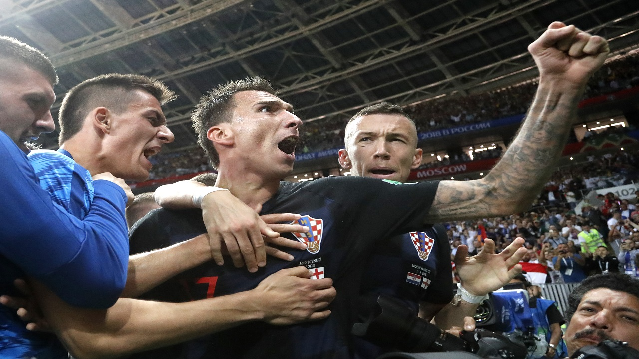Croatia's Mario Mandzukic, center, celebrates after scoring his side's second goal during the semifinal match against England at the 2018 football World Cup in the Luzhniki Stadium in Moscow, Russia, Wednesday, July 11, 2018. (AP Photo/Frank Augstein).