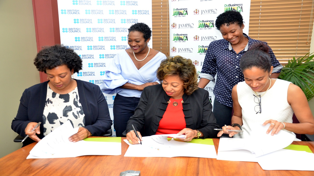 (L-R, seated) Olayinka Jacobs Bonnick, Country Director, British Council Jamaica; Diane Edwards, President of JAMPRO and Analisa Chapman, President of the Jamaica Film and Television Association (JAFTA) sign a Memorandum of Understanding (MOU) cementing their partnership for the film development programme - Film Lab. (L-R, standing) Renee Robinson, Film Commissioner,JAMPRO and Past JAFTA President, Gabrielle Blackwood view the signing.