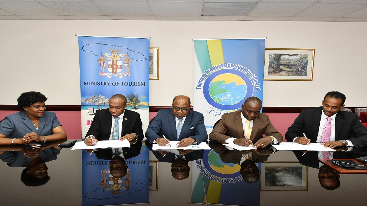 Tourism Minister, Edmund Bartlett (centre), along with (L-R) Permanent Secretary in the ministry, Jennifer Griffith; Executive Director of the Tourism Product Development Company, Dr Andrew Spencer; Executive Director of the National Solid Waste Management Authority (NSWMA), Audley Gordon; and Executive Director of the Tourism Enhancement Fund (TEF), Dr Carey Wallace, participate In the signing of a contract on Monday, to implement the Tourism Resort Maintenance programme.