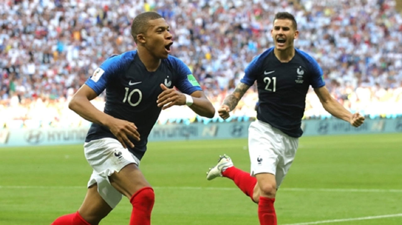 Kylian Mbappe (left) leads France celebrations against Argentina in their World Cup round of 16 match at the 2018 football World Cup at the Kazan Arena in Kazan, Russia, Saturday, June 30, 2018.