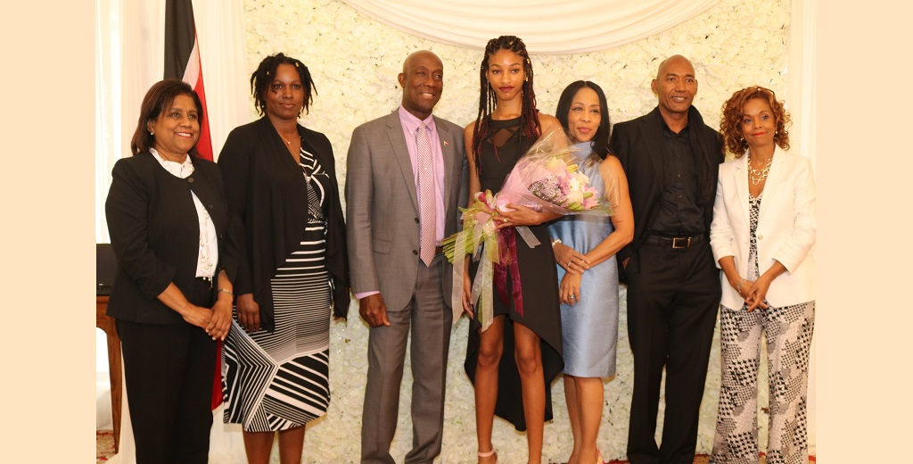 Prime Minister Dr Keith Rowley (centre), Naomi Chin Wing (centre-right), Mrs Sharon Rowley (third from right), Christopher Nathan, CEO of Coco Velvet International Fashion & Model Management (second from right).