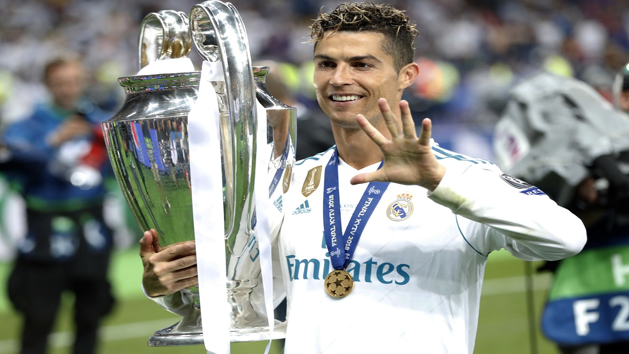 In this Saturday, May 26, 2018 file photo Real Madrid's Cristiano Ronaldo celebrates with the trophy after winning the Champions League Final match between Real Madrid and Liverpool at the Olimpiyskiy Stadium in Kiev, Ukraine. (AP Photo/Pavel Golovkin)