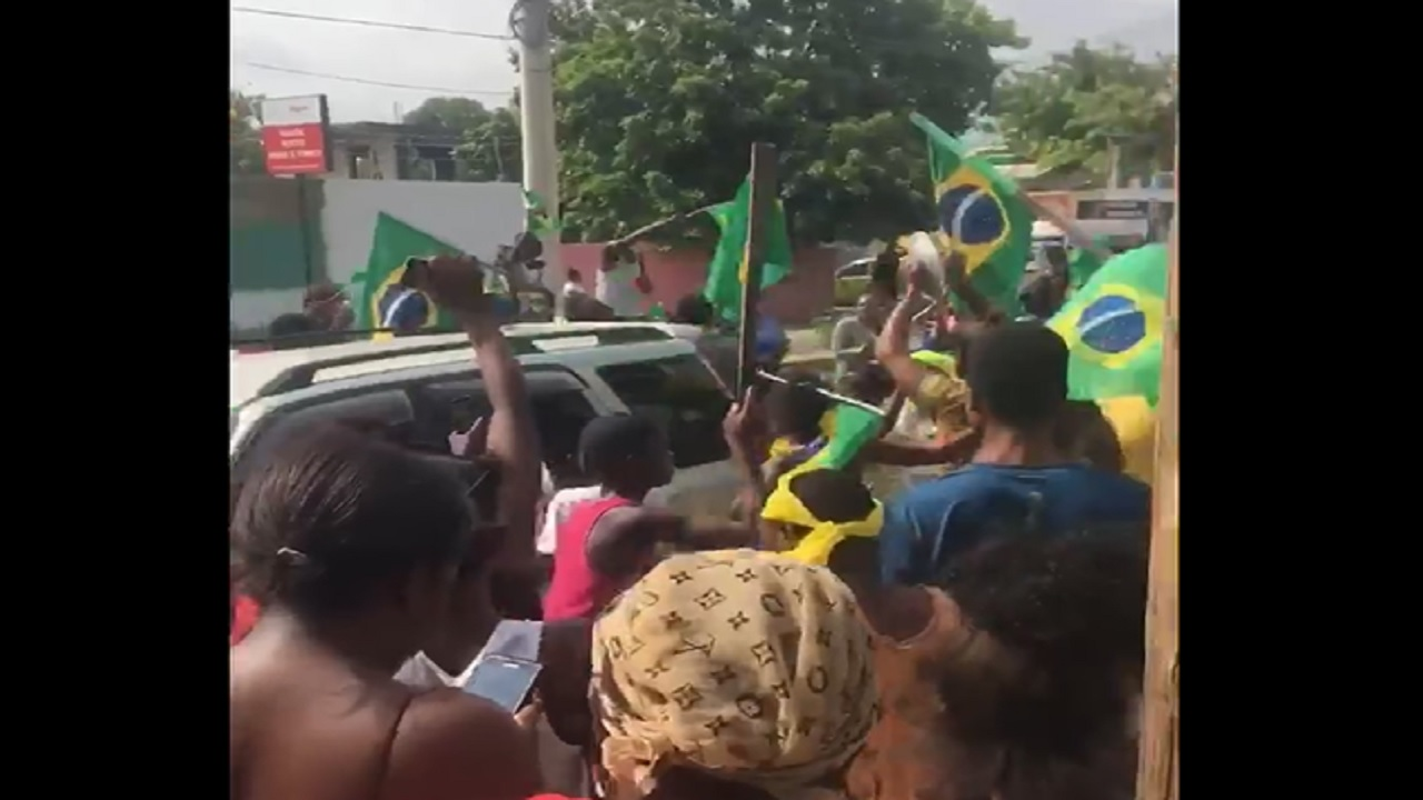 Screenshot of a video showing Trench Town residents celebrating Brazil's victory over Serbia in the World Cup.