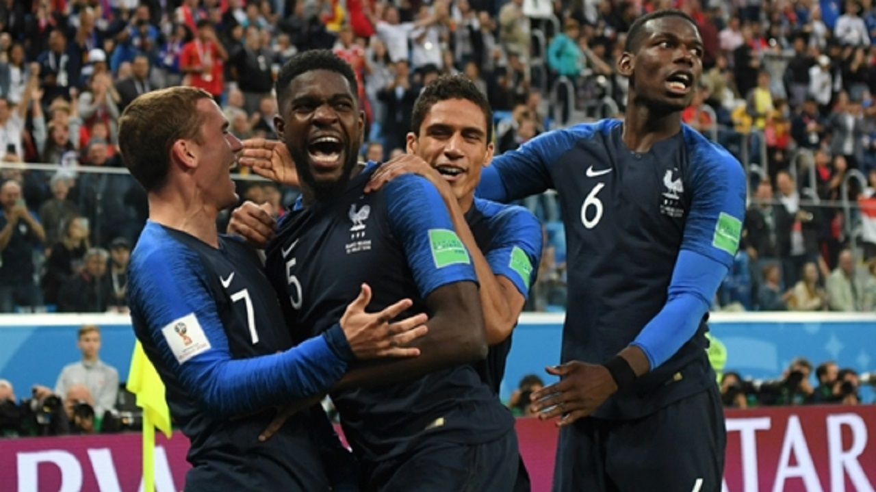 France players celebrating (from left) Antoine Griezmann, Samuel Umtiti, Raphael Varane and Paul Pogba.