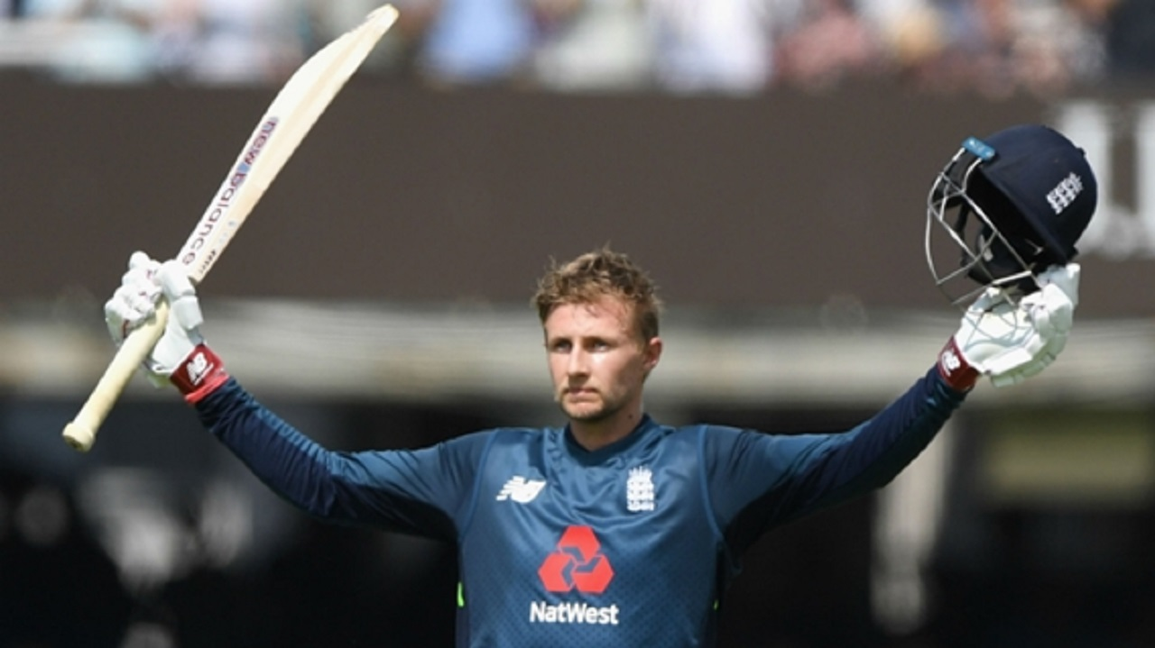 Joe Root celebrates reaching his 12th ODI hundred for England.