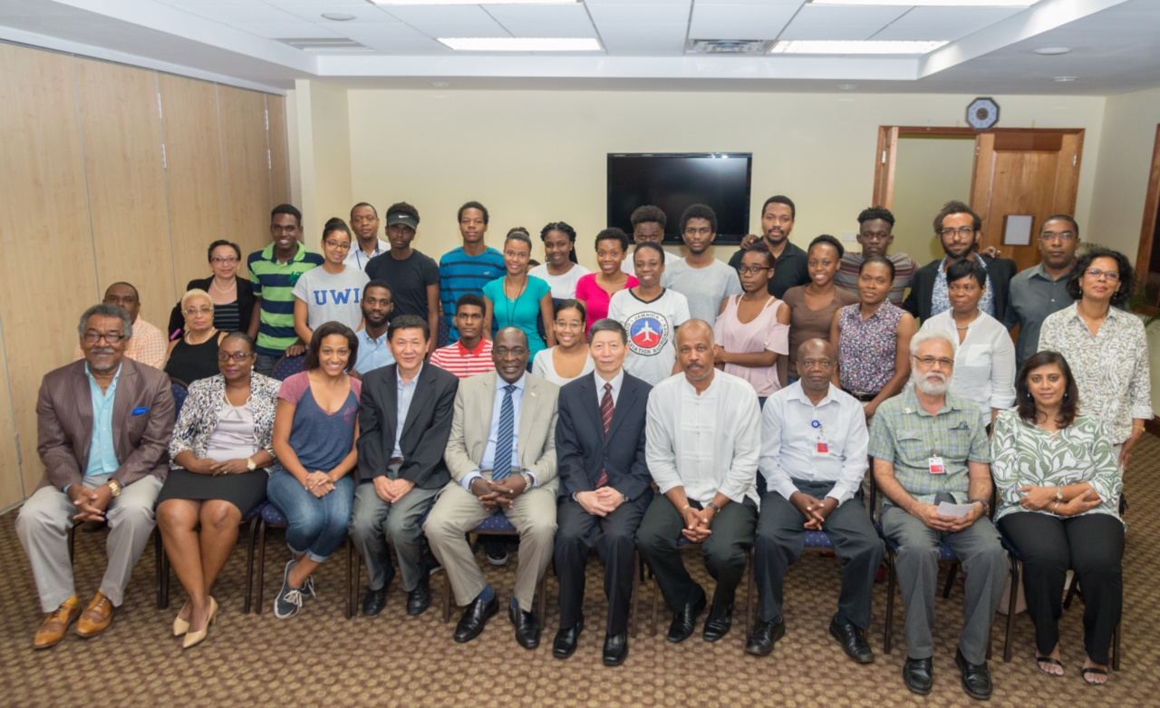 Administrators from the Global Institute of Software Technology (GIST) pictured with UWI Vice-Chancellor Professor Sir Hilary Beckles (4th from right) along with Administrators and students of The UWI China Institute of Information Technology (UWICIIT) BSc Software Engineering programme in Mona Jamaica. Principal of GIST, Dr. Xiulan Zhu is seated 5th from right and Director of International Programmes and Mr. Lu Ning is seated 4th from left.
