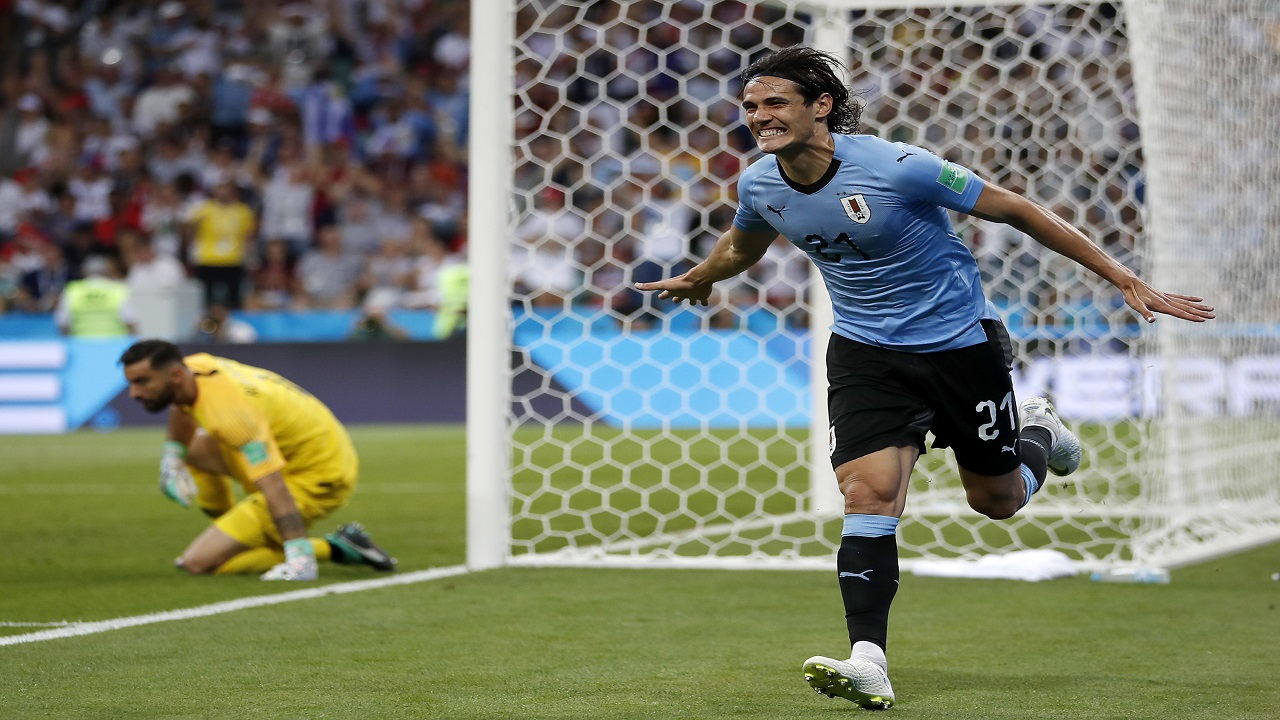 Uruguay's Edinson Cavani celebrates after he scored the opening goal during the round of 16 match against Portugal at the 2018 football World Cup at the Fisht Stadium in Sochi, Russia, Saturday, June 30, 2018. (AP Photo/Francisco Seco).