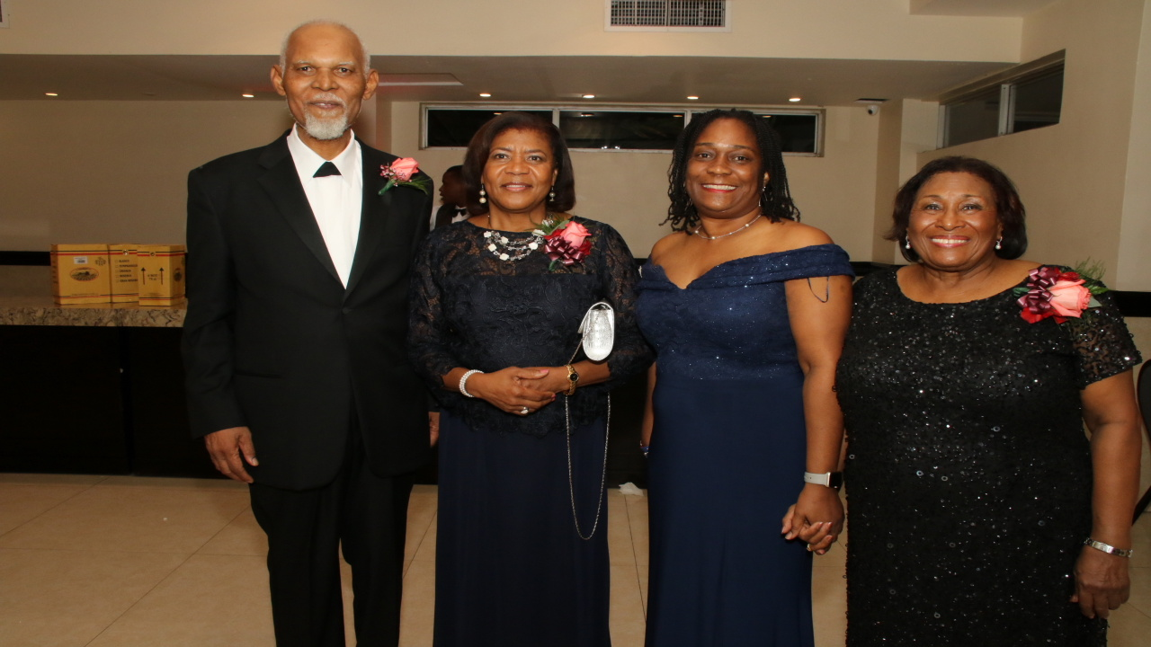 From left to right: KD Knight, Retired Chief Justice Zaila McCalla, Jamaica Bar Association President Jacqueline Cummings and Dorothy Lightbourne share a moment at the awards banquet last Friday.