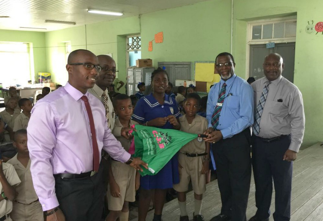COB Staff, Algernon Yearwood (far right) and Joseph Holder (second right) with teaching staff, Kemar Cumberbatch (left) and Principal, Herbert Gittens (second left).  Also pictured are students Haylun Wood, Danielle Scott and Jaleel Cobham.