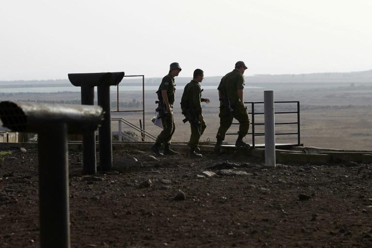 Des soldats israéliens dans le sud de la partie du plateau du Golan occupée et annexée par Israël, près de la province syrienne de Deraa, le 24 juillet 2018