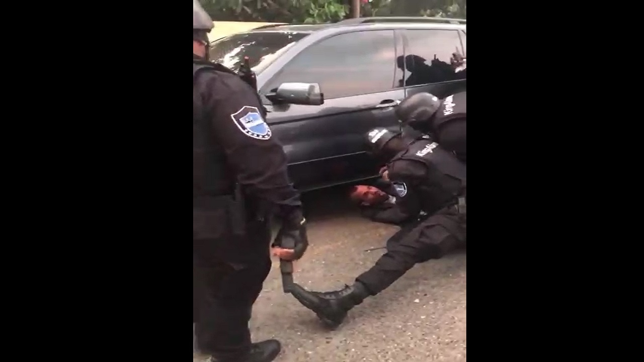Screenshot of video showing KingAlarm security officers tussling with a licensed firearm holder at an apartment complex in New Kingston on Monday.