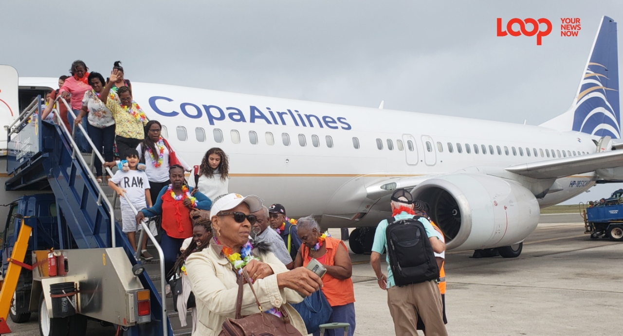 Passengers disembarking first Copa Airlines direct flight from Panama City to Barbados.