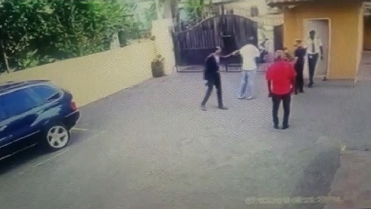 Screenshot of a video showing a dispute between a security guard and other men at Braemar Estate in St Andrew.