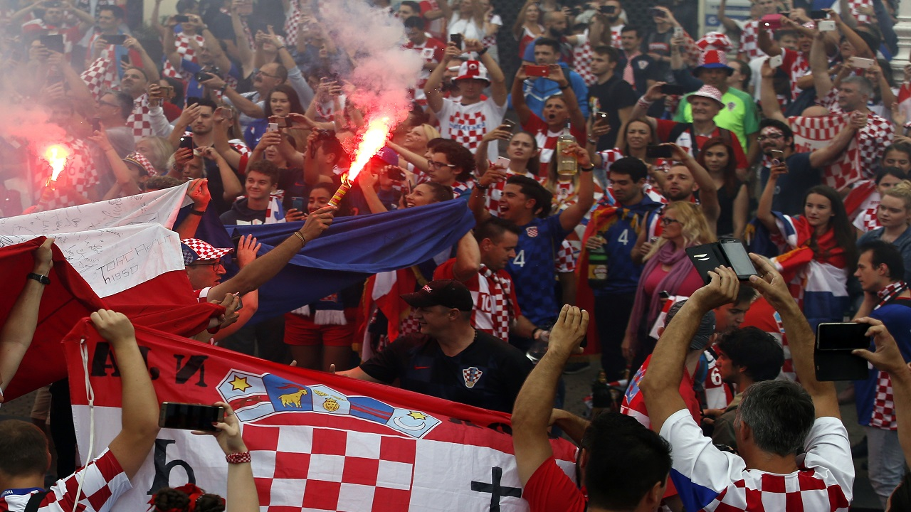 Croatia football fans shout chants and cheer prior to a television broadcast of the Russia 2018 World Cup match between France and Croatia in downtown Zagreb, Croatia, Sunday, July 15, 2018. (AP Photo/Darko Vojinovic).