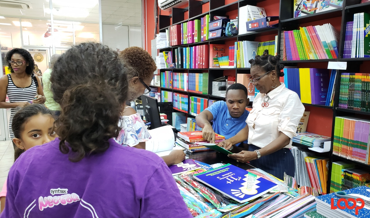 Parents getting help in Cloister Bookstore as they try to get everything on booklists.