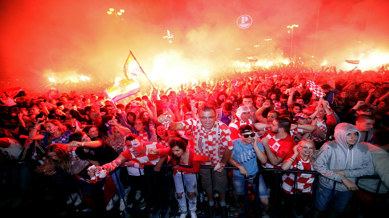 In this July 11, 2018 file photo, Croatian fans cheer while watching the semifinal match between Croatia and England at the 2018 World Cup, in Zagreb, Croatia. (PHOTO: AP)