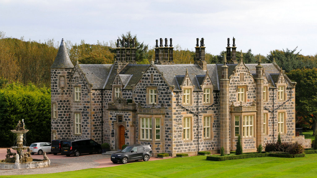 "FILE - This Friday Oct. 6, 2017 file photo shows a view of MacLeod House, a sixteen room boutique hotel, at the Trump International golf course in Balmedie, Scotland. Documents show that U.S. President Donald Trump's family business has ""destroyed the vast majority'' of an environmentally sensitive patch of sand dunes near its golf course north of Aberdeen in Scotland. (AP Photo/Renee Graham, file)"
