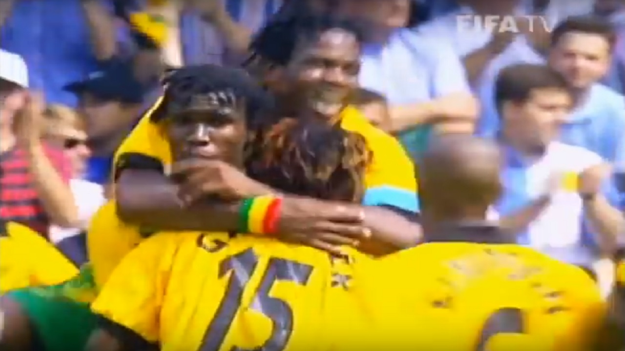 Screenshot of a video showing Theodore Whitmore being swarmed by other members of the Jamaican national football team after scoring against Japan in the 1998 World Cup in France.