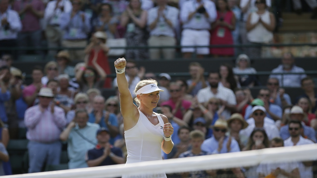 Kiki Bertens of the Netherlands celebrates defeating Venus Williams of the US in their women's singles match on the fifth day at the Wimbledon Tennis Championships in London, Friday July 6, 2018. (AP Photo/Tim Ireland).