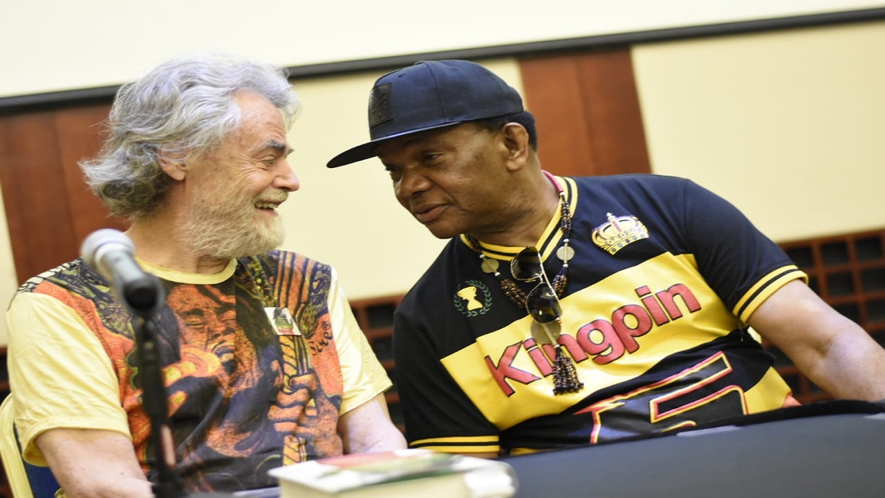 Roger Steffens, a Bob Marley historian and collector, and artiste manager and longtime reggae music insider, Copeland Forbes, in discussion at the symposium. (PHOTOS: Marlon Reid)