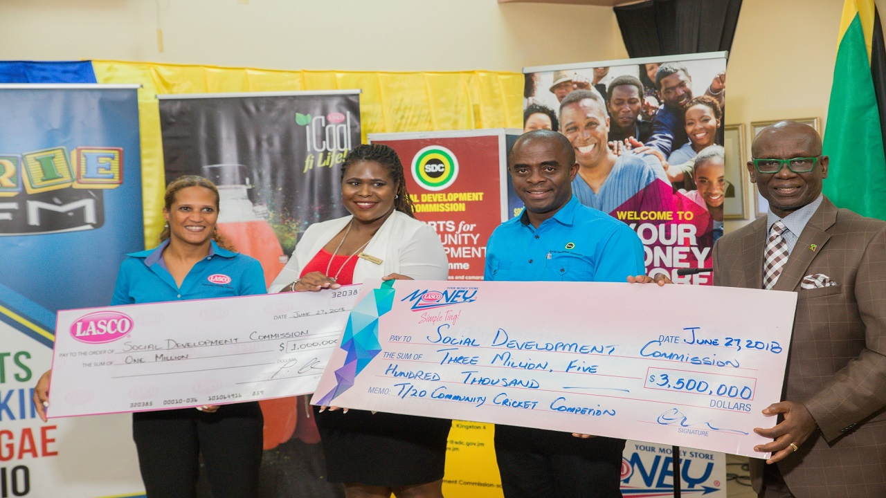 (l-r) Beverage Marketing Manager, LASCO Distributors Limited, Danielle Cunningham; Senior Marketing Communications Executive, LASCO Financial Services Limited (LFSL), Danielle Harris-Drysdale; Executive Director, Social Development Commission (SDC), Dr Dwayne Vernon and Minister of Local Government and Community Development, Desmond McKenzie display symbolic sponsorship cheques.