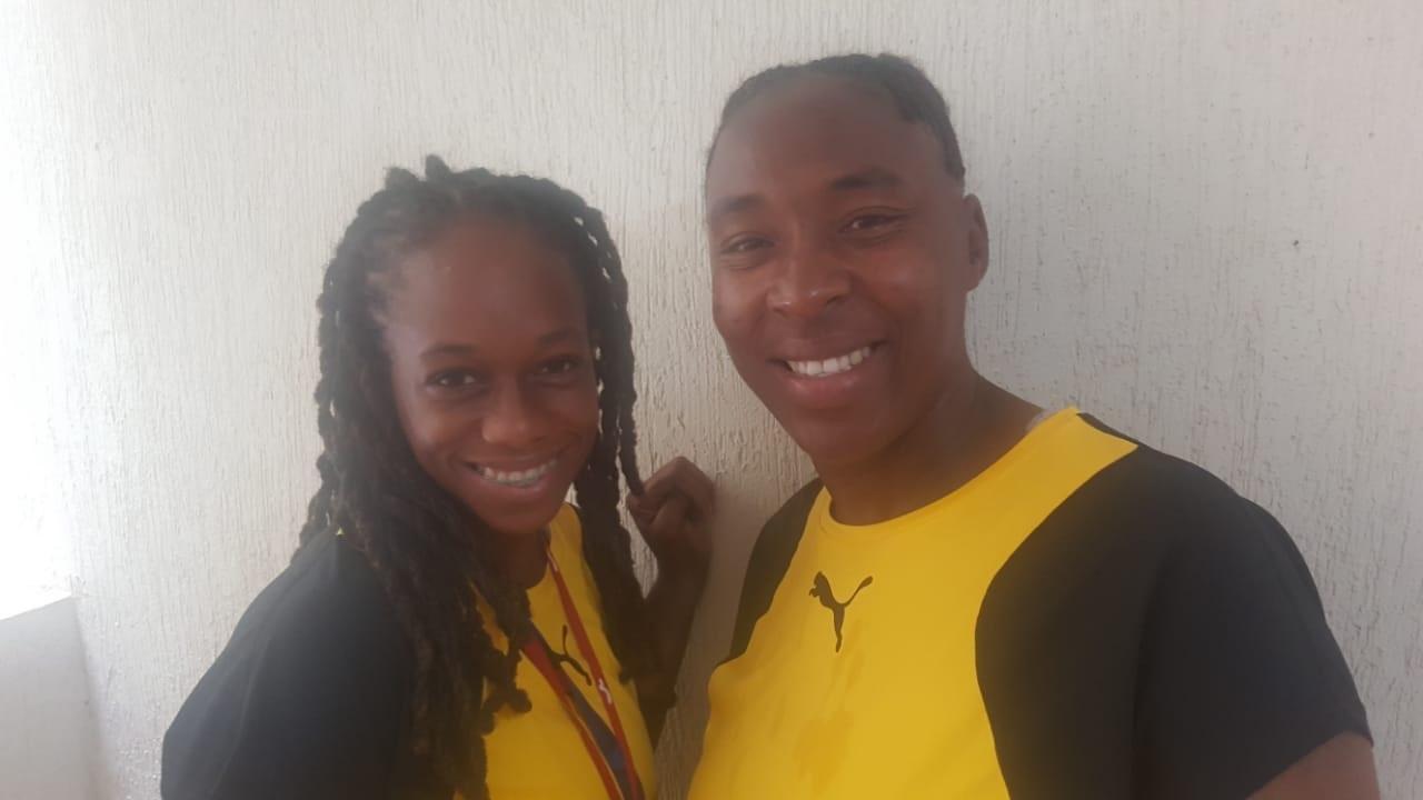 Christine Bartley (right), Jamaica's senior women's field hockey team coach and Demi Nicholson, a member of Team Jamaica.