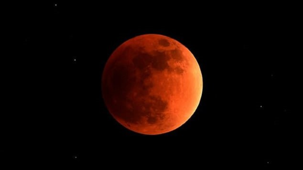 Blood moon dazzles star gazers in longest lunar eclipse of 21st century